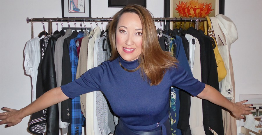 mvl in navy in front of clothing racks